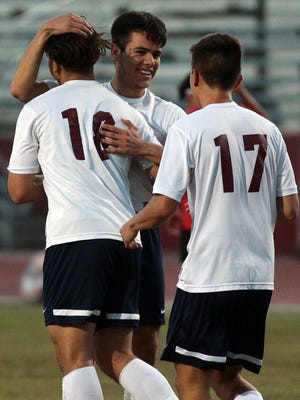 Quinta senior Jesus Avalos (center) was named the CIF Player of the Year.