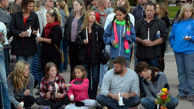 A vigil is held for the Strack family at Pioneer Park in Provo, Utah after the family of five who were mysteriously found dead in their Springville home last Saturday. A Springville Police news release identified them Sunday as Benjamin Strack, 37, his wife, Kristi Strack, 36, two of their sons, Benson Strack, 14, and Zion Strack, 11, and their daughter Emery Strack, 12. Preliminary autopsies ruled out any sort of violent assault, according to the release.