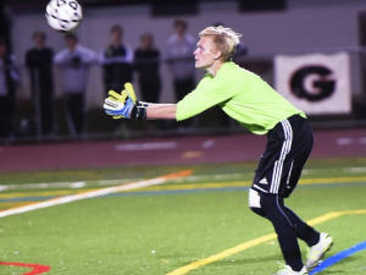 Chambersburg goalkeeper Chandler Schur makes a save against Hempfield on Tuesday. Schur grabbed five saves, all in the first half, and the Trojans won, 2-0, in the first round of the District 3 Class AAA playoffs.