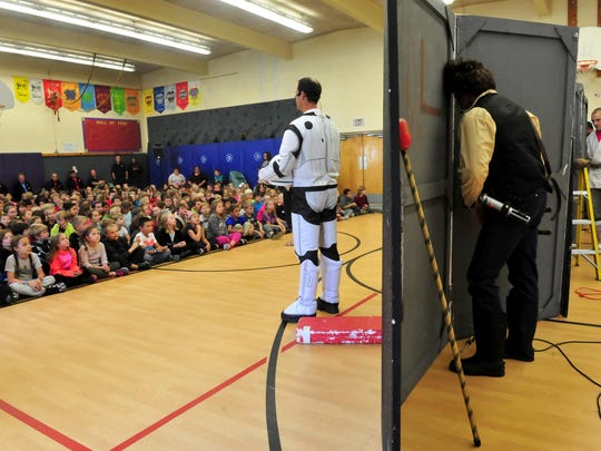 """Great Falls Fire/Rescue performs its """"Star Wars""""-themed fire safety and prevention skit as part of fire prevention week Thursday at Sacajawea Elementary School."""