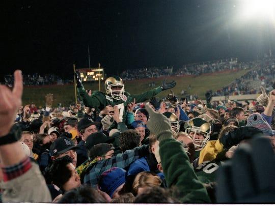 CSU football fans hoist former quarterback Anthoney