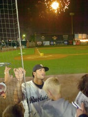 Revolution outfielder Justin Singleton talks with fans
