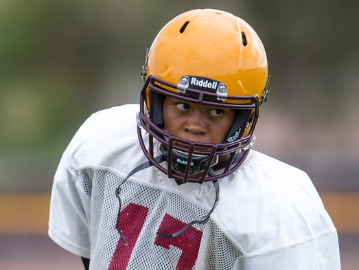 Mountain Pointe High School's starting quarterback Garvin Alston warms up before football practice at the Phoenix school on Tuesday, Aug. 12, 2014. The team is gearing up for its Aug. 23 season opener in Las Vegas against Sparks, NV Reed High School.