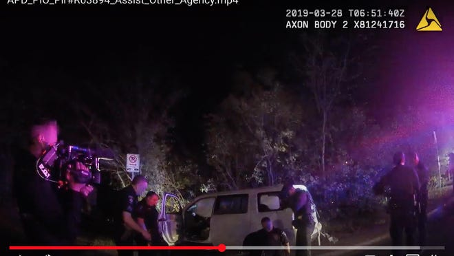 """In this footage from an Austin police officer's body camera, crews from """"Live PD"""" can be seen, at left, filming during the arrest of Javier Ambler II after a police chase that started in Williamson County. Williamson County sheriff's deputies used a stun gun on Ambler, who had congestive heart failure, multiple times before he lost consciousness and later died."""