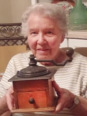 Helen Jordan shows off her coffee grinder that her mother used to grind coffee for the vagabonds.