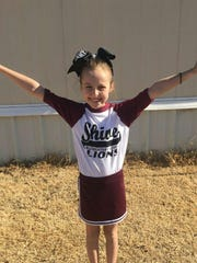 Vanessa Tyra, 10, is pictured in her cheerleading uniform supporting the Shive Lions, Vernon's elementary school. Tyra tragically lost her life in a rollover car wreck May 24.