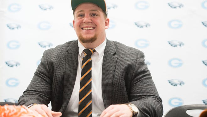 Ollie Lane, Gibbs High School offensive lineman, poses after signing with the University of Tennessee at an early signing day ceremony at Gibbs High School in Corryton, Tenn., Wednesday, Dec. 20, 2017.