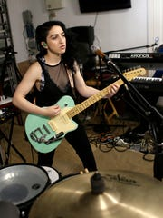 In this Jan. 31, 2017 photo, Emily Estefan practices with her band in the garage of her late grandparent's mansion in Miami Beach, Fla.