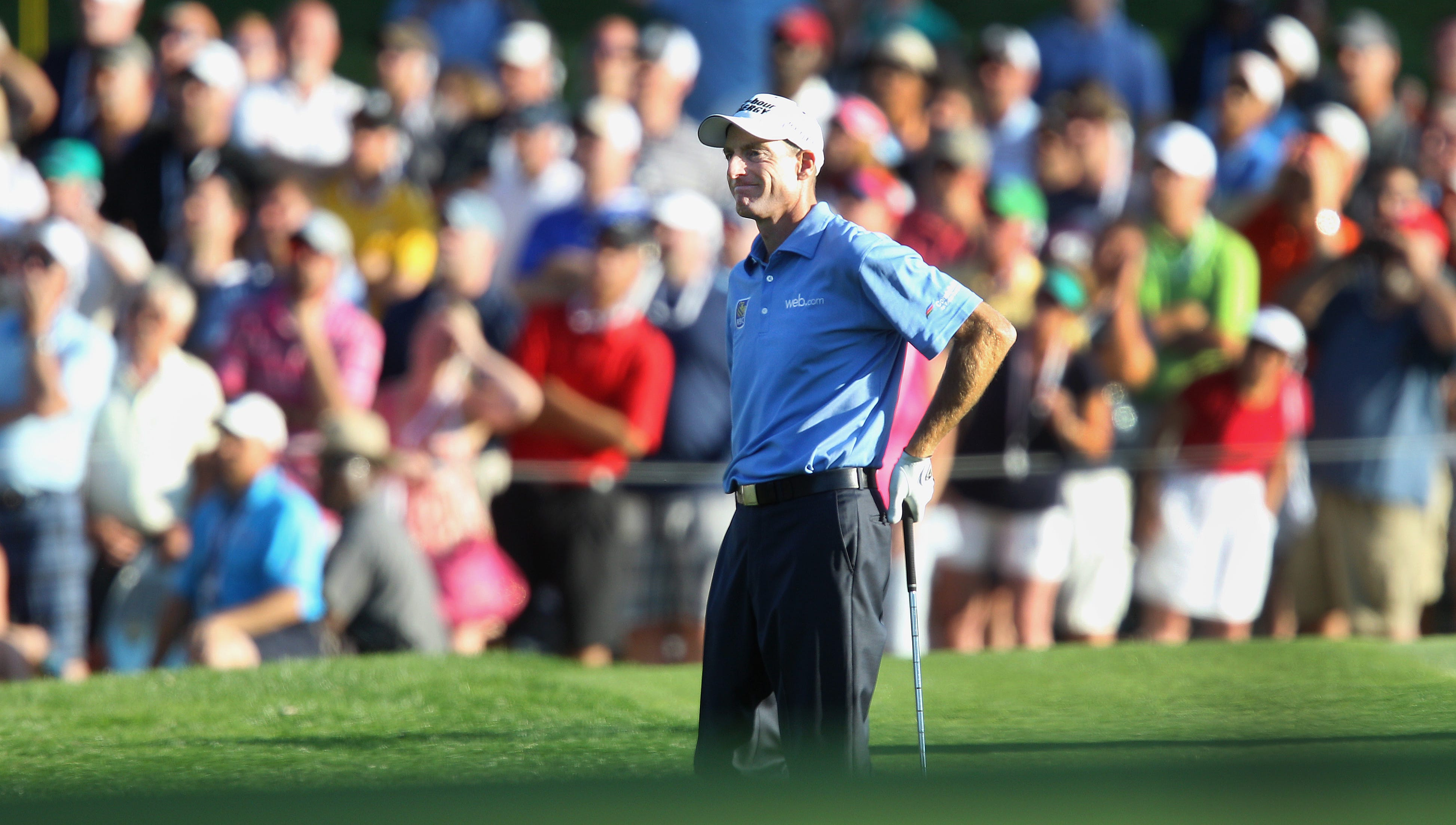 Jim Furyk isn't too happy with his shot to the green on 18.  It was short of the mark.
