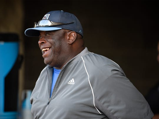 Rox third-base coach Al Newman smiles while talking
