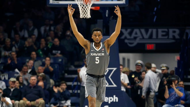 """Xavier Musketeers guard Trevon Bluiett (5) throws up """"three"""" after a shot from behind the arc in the first half of the NCAA basketball game between the Xavier Musketeers and the Baylor Bears at the Cintas Center in Cincinnati on Tuesday, Nov. 28, 2017."""