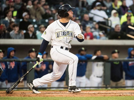 Columbia Fireflies' Tim Tebow watches his home run in his first at bat on the opening day during a Class A South Atlantic League baseball game against the Augusta GreenJackets on April 6, in Columbia, South Carolina.
