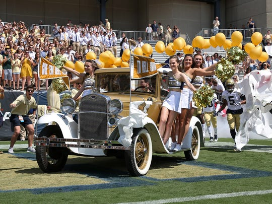 Georgia Tech Yellow Jackets cheerleaders ride on the
