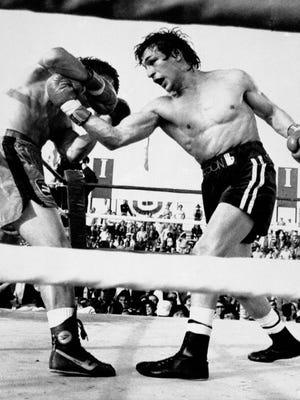 """Ray """"Boom Boom"""" Mancini, right, throws an uppercut to the body of Duk-koo Kim during their lightweight title fight in Las Vegas Nov. 13, 1982. Mancini retained his crown with a 14th-round knockout. Duk-koo Kim was carried out of the arena on a stretcher and died four days later from the injuries suffered in the bout."""