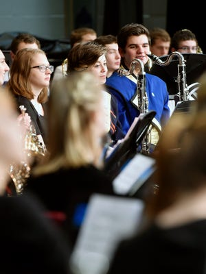 Members of the sixth annual York County High School Honors Band prepare for their concert Saturday, Feb. 13, 2015, at York Suburban Middle School. The band, consisting of 125 high school musicians from 17 York County school districts, was guest-conducted by Stanley Schoonover, the music director of the Fairfax Wind Symphony in Virginia.