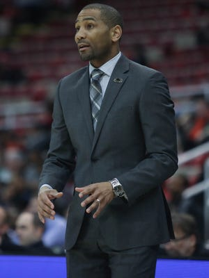 Milwaukee coach LaVall Jordan on the bench during the first half of UDM's 85-60 loss to Milwaukee in the first round of the Horizon League tournament Friday at Joe Louis Arena.