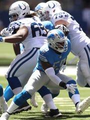 Lions linebacker Tahir Whitehead rushes against the