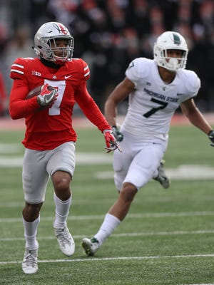 Ohio State' s Damon Webb had one of two interceptions against Michigan State on Saturday.