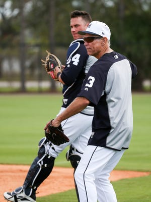 Tigers catcher James McCann and former Tiger Alan Trammell watch drills during spring training on Tuesday, Feb. 20, 2018, at Joker Marchant Stadium in Lakeland, Fla.