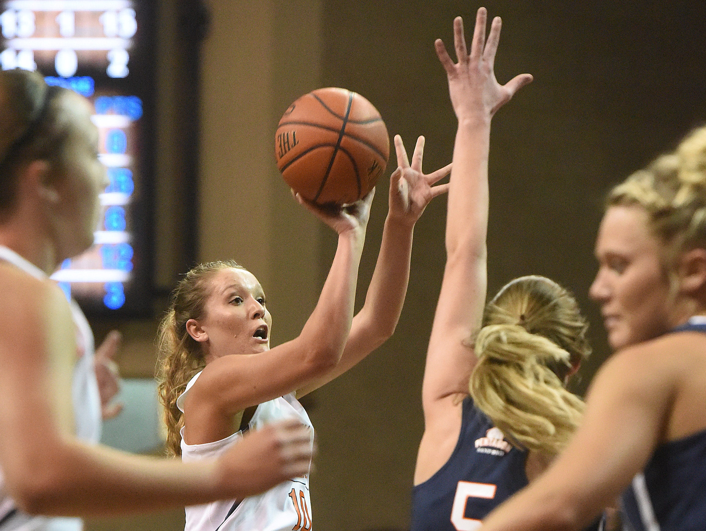 The White Team's Ali Kuca (10) shoots over the Blue Team's Anna Goodhope (5) during the Argus Leader/Sanford Pentagon First Five All-Star Game on Sunday, April 10, 2016, at the Sanford Pentagon in Sioux Falls.