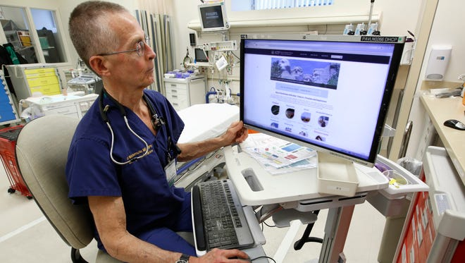 Dr. Garen Wintemute, an emergency room physician at the University of California, Davis, Medical Center, shows the website of the Bureau of Alcohol, Tobacco and Firearms, on a computer in the hospital in Sacramento, Calif., on Thursday, March 9, 2017. On the day President Donald Trump was inaugurated, Wintemute got a call from a colleague, who reported that the White House had removed a climate change page from its website. Fearing that federal data on gun violence might soon similarly vanish under a president with close ties to the National Rifle Association, Wintemute called together his partners at the UC Davis Violence Prevention Research Program. He then ticked off the records he wanted to archive. (AP Photo/Rich Pedroncelli)