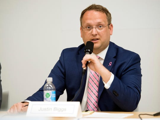 Knox County Commission District 11 republican candidate Justin Biggs answers questions during a candidate forum hosted by the League of Women Voters on Wednesday, April 18, 2018.