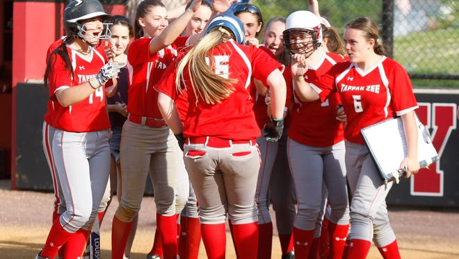 Tappan Zee's Nicole Spiegelberg (16) is greeted at home by her teammates after hitting her second home-run during a softball game at Nyack High School on Thursday, May 12, 2016.