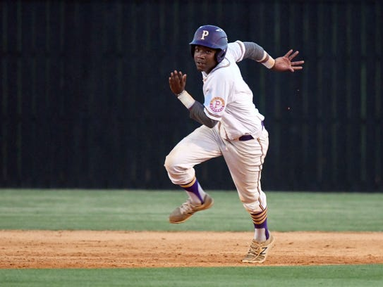 Purvis' Keyshawn Bolar runs between bases in a game
