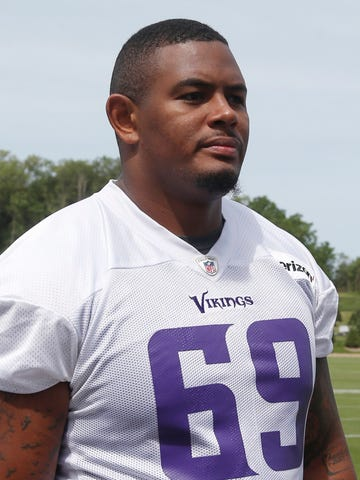 FILE - In this June 14, 2018 file photo Minnesota Vikings tackle Rashod Hill leaves the field after practice at the NFL football team's training camp in Eagan, Minn. Hill has advanced in his NFL career from undrafted practice squad player with Jacksonville to frontrunner to start at right tackle this season for Minnesota. As the Jaguars and Vikings prepare for two days of joint practices, Hill has a moment to reflect on his progress. (AP Photo/Jim Mone)