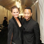 Chrissy Teigen and John Legend pose outside the Samsung Galaxy Lounge at Mercedes-Benz Fashion Week Spring 2014 Collections at Lincoln Center on Sept. 10, 2013 in New York City.