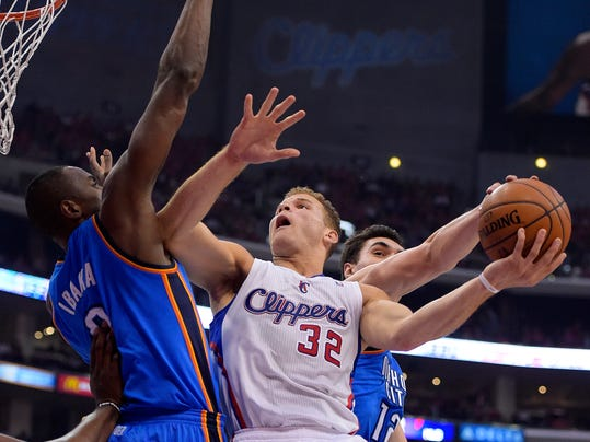 Los Angeles Clippers forward Blake Griffin, center, has his shot blocked by Oklahoma City Thunder center Steven Adams, right, of New Zealand, as forward Serge Ibaka, of Congo, defends in the first half of Game 6 of the Western Conference semifinal NBA basketball playoff series, Thursday, May 15, 2014, in Los Angeles. (AP Photo/Mark J. Terrill)