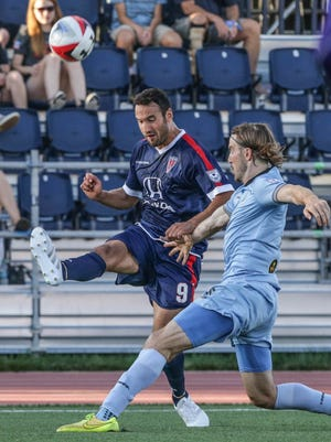 FILE -- Indy Eleven's #9 Eamon Zayed, left, had a shot on goal in the NASL title match Sunday. This photo was taken earlier in the season.