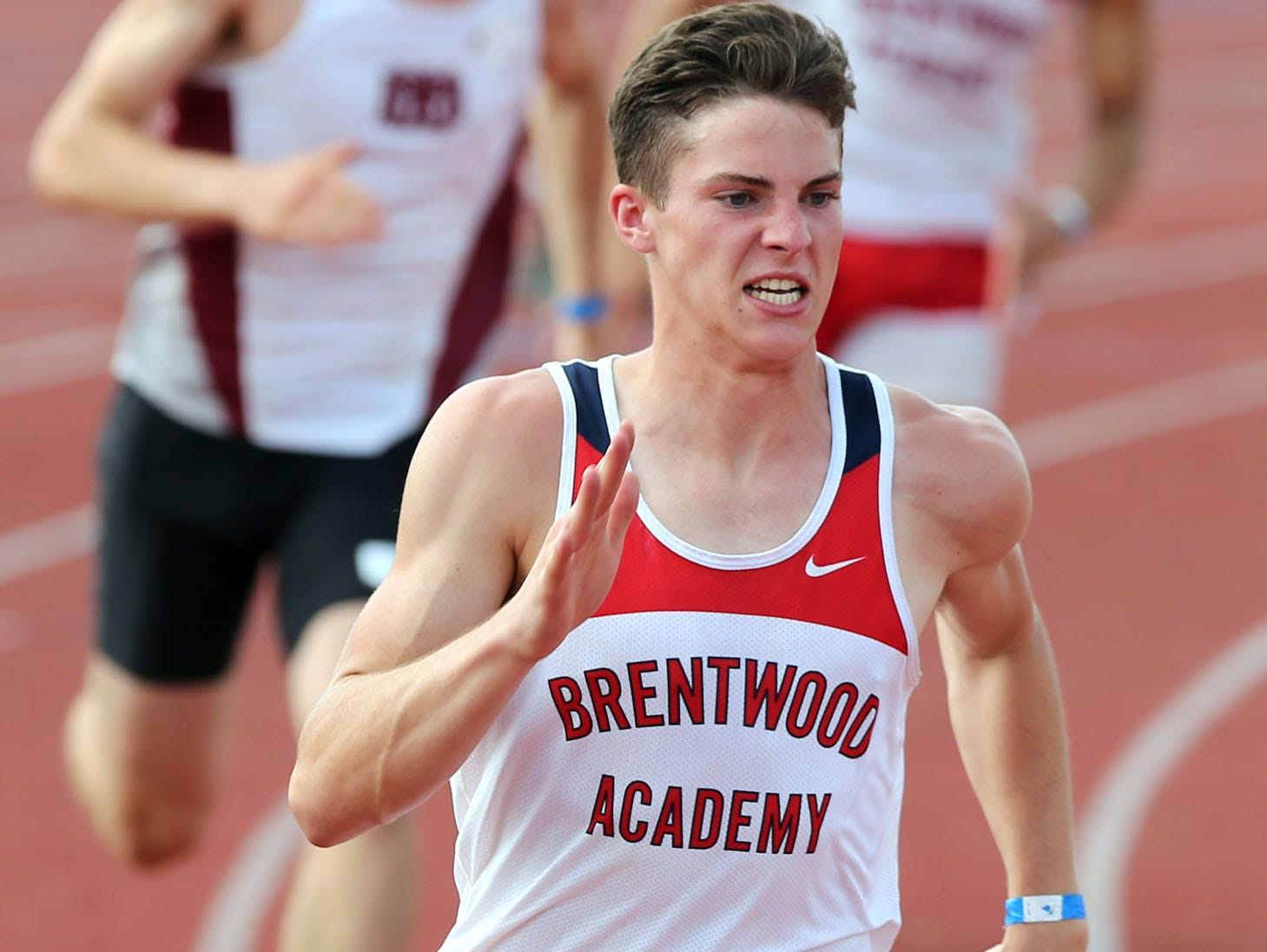 Brentwood Academy's George Patrick competes in the 400-meter dash during the DII decathlon. Patrick captured the title by almost 1,000 points.