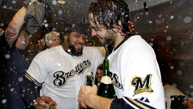 The Brewers'  Ryan Braun and Prince Fielder celebrate after winning the NL Central title in 2011.