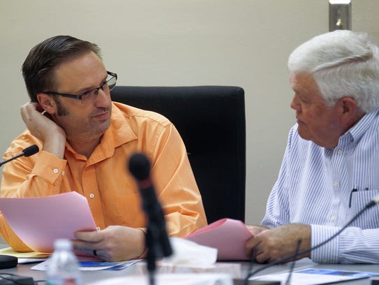 San Juan Water Commission Chairman John Beckstead, left, and Commissioner Jay Burnham talk before the beginning of the San Juan Water Commission meeting Wednesday in Farmington.