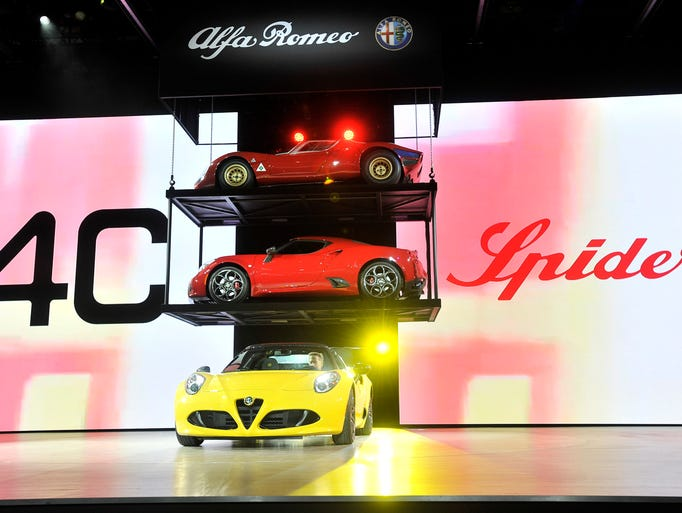 The 4C Spider, bottom, rolls onstage at the Alfa Romeo