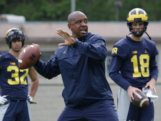 Michigan assistant coach Pep Hamilton runs through