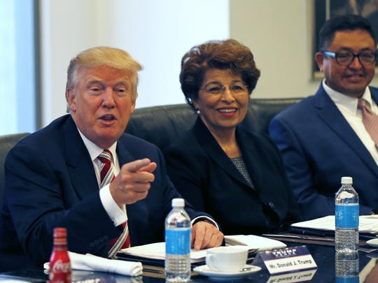 Michigan State University professor Joseph Guzman (far right) is a member of Donald Trump's National Hispanic Advisory Council. Guzman has been shamed by some students who disagree with his political activities.