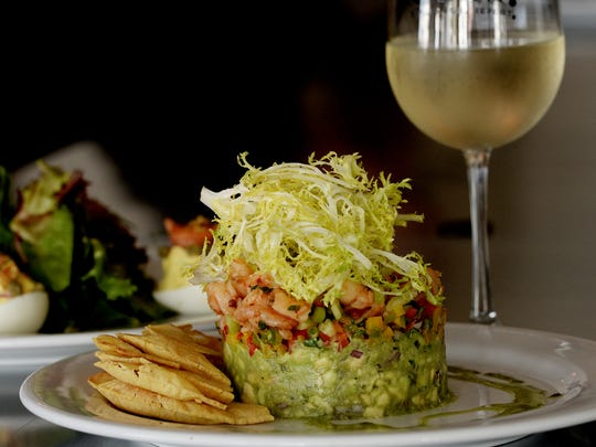 An attractive and colorfull Avocado shrimp stack offered at the Cork restaurant.