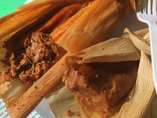 Eat the pumpkin tamale (right) with the hot and spicy pork tamale (left) at The Tamale Place.