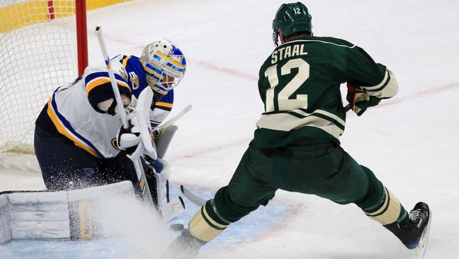 Minnesota Wild center Eric Staal (12) is stopped by St. Louis Blues goalie Jake Allen (34) during the first period of an NHL hockey game Sunday, Dec. 11, 2016, in St. Paul, Minn. (AP Photo/Andy Clayton-King)