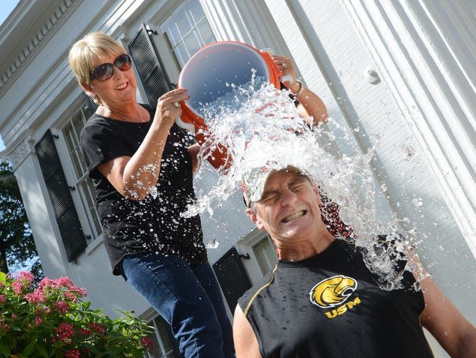 First Lady Deborah Bryant does the honors as Gov. Phil Bryant takes the Ice Bucket Challenge outside the Governor's Mansion on Friday in support of the Louisiana-Mississippi Chapter of the ALS Association.