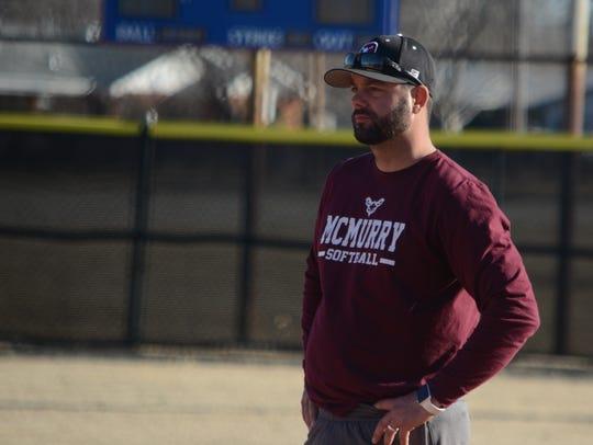 McMurry softball coach David McNally watches his team