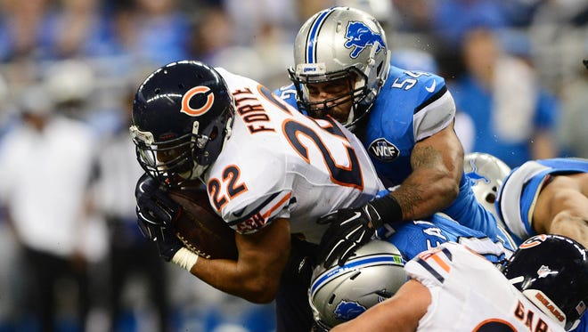 Chicago Bears running back Matt Forte gets tackled by the Detroit Lions during the second quarter at Ford Field.