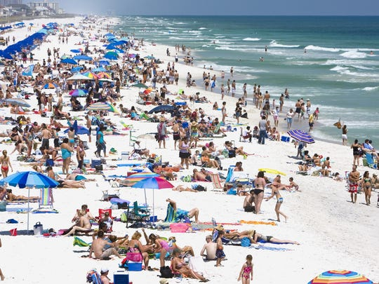 Beachgoers flock to the sands of Casino Beach  for fun and great weather.