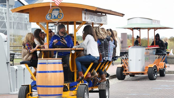 A Nashville Pedal Tavern party bike carries patrons in this USA TODAY NETWORK file photo. The Oshkosh Common Council will consider Sept. 25 whether to allow party bikes within the city.