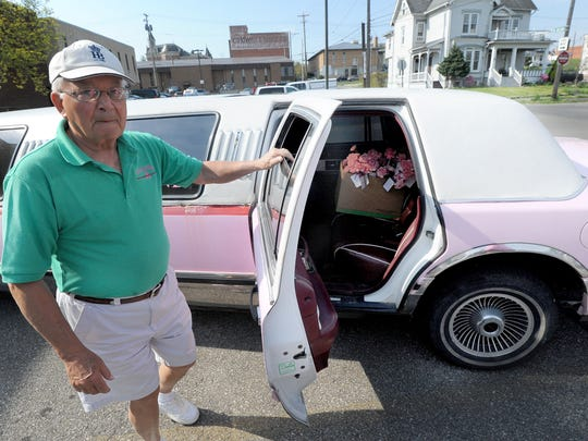 Dave Kracker, of the Pat Kracker Breast Cancer Fund, rode around in Paul Lintern's pink limo Friday morning delivering pink carnations in honor of Mother's Day to women who have survived breast cancer and other health problems.
