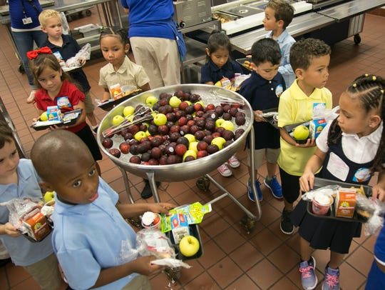 Caloosa Elementary School students grab lunch as they