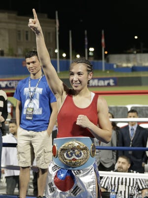 Jennifer Han celebrates after her win over Calixta Silgado on April 29 at Southwest University Park to retain her IBF world featherweight title.