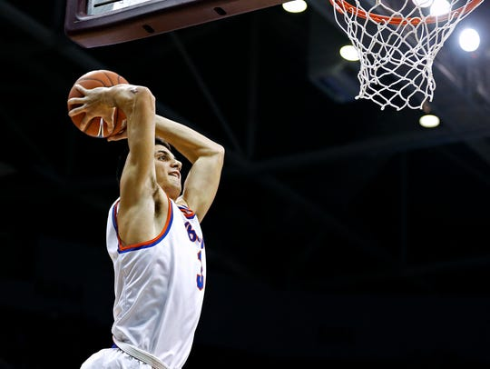 Rainier Beach High School guard Sam Cunliffe (3) dunks